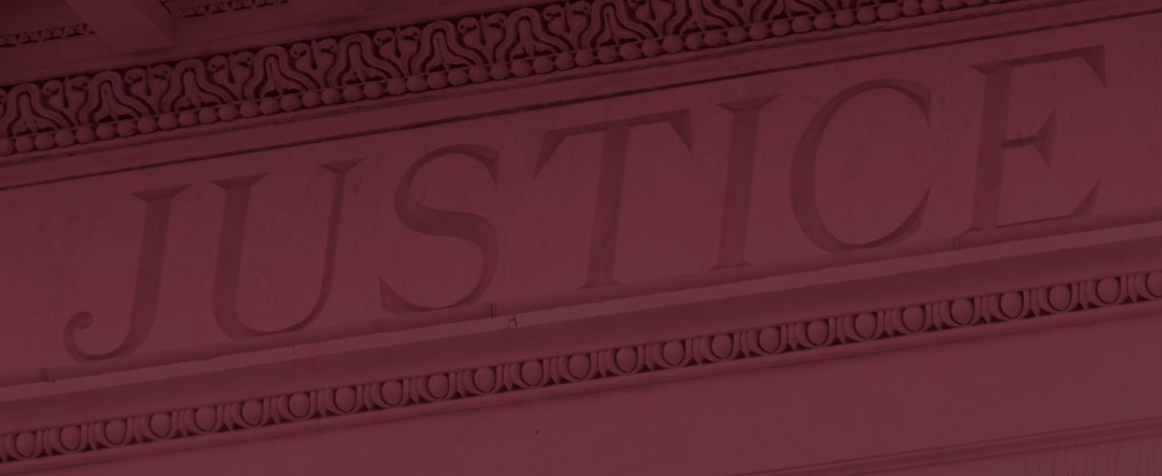 Outside of criminal justice building, the word 'Justice' carved
