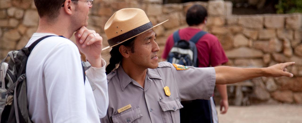 U.S. Park Ranger directs man at a Grand Canyon National Park