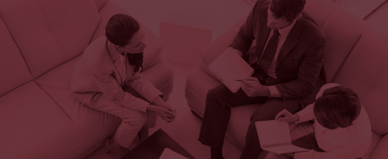 Colleagues discuss business solutions in office breakout space