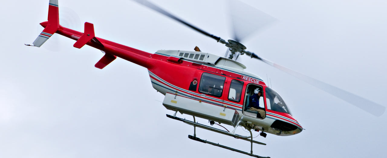 Emergency medicine helicopter flying through the sky