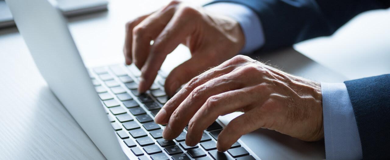 Paralegal types on laptop keyboard