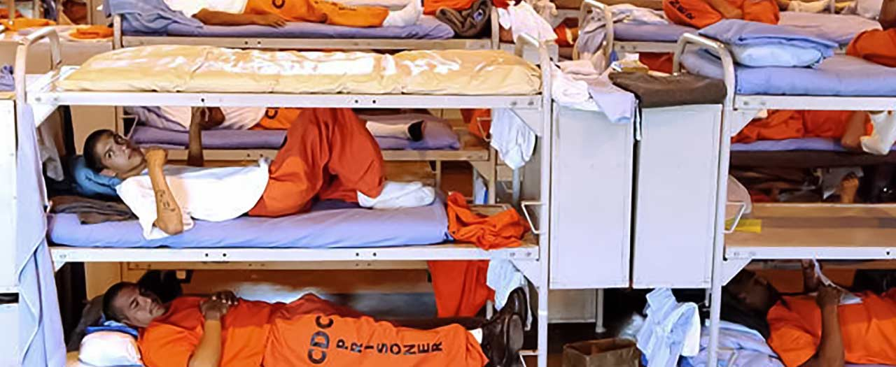 Prison bunks crowded with inmates