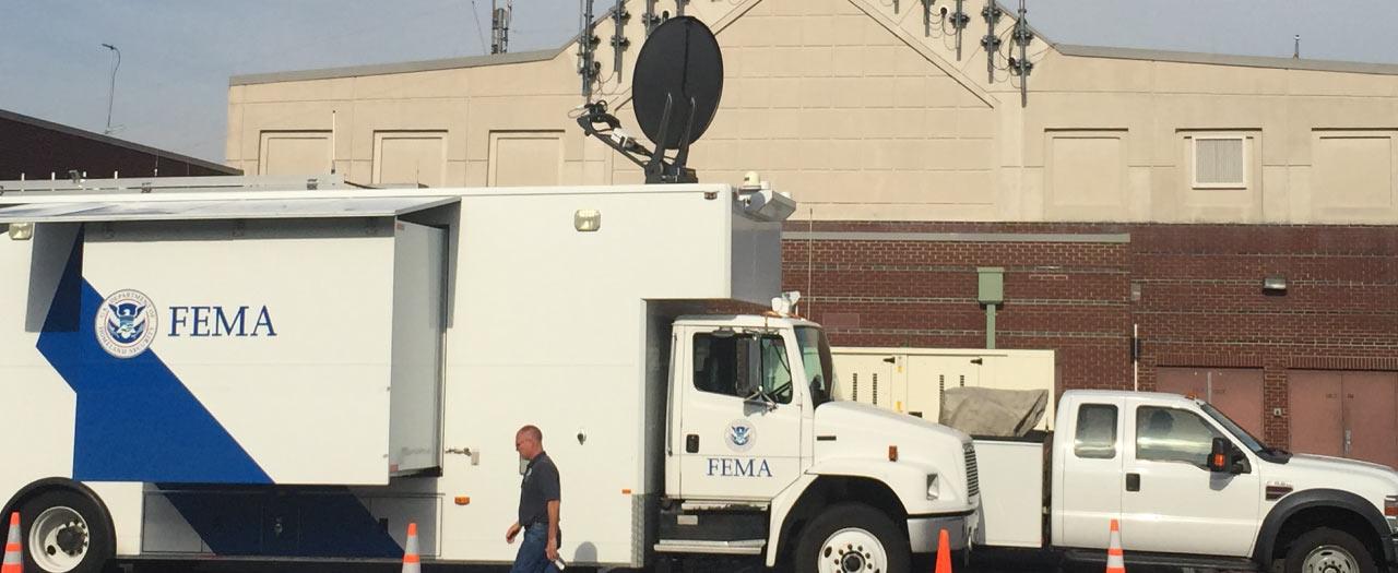 FEMA Surveillance Vehicles parked outside of headquarters