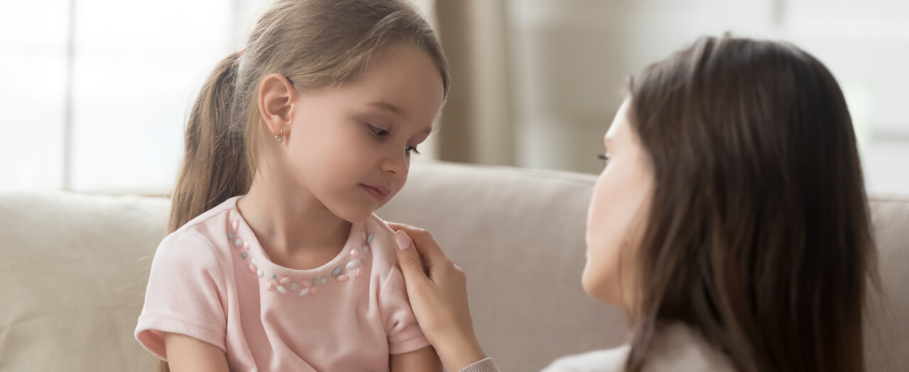 Child and Family Studies professional comforts and speaks to a child