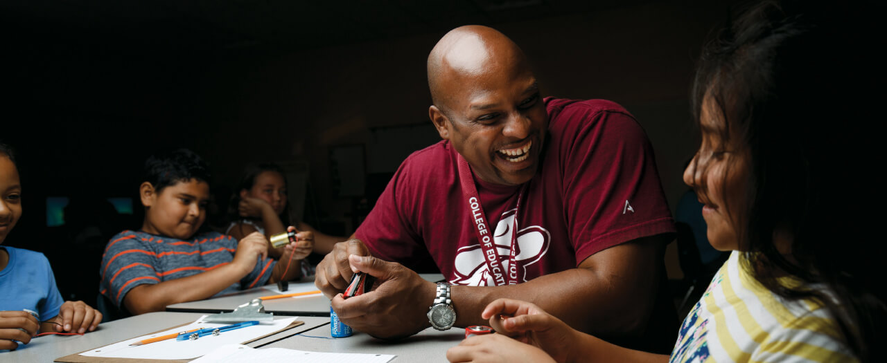 EKU Education student working with young students