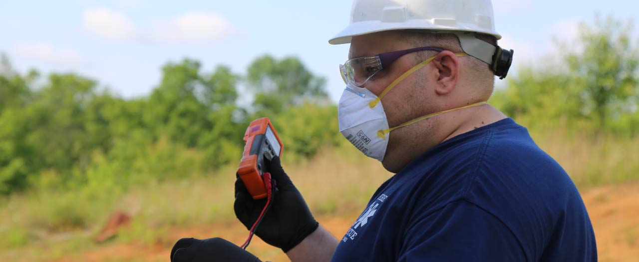 Fire Investigator working with protective mask on