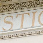 Justice, carved in building facade
