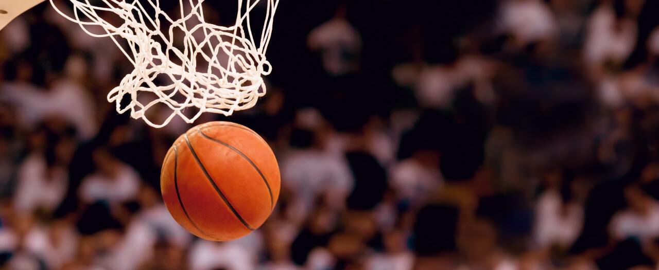 Basketball falls through hoop at college basketball game