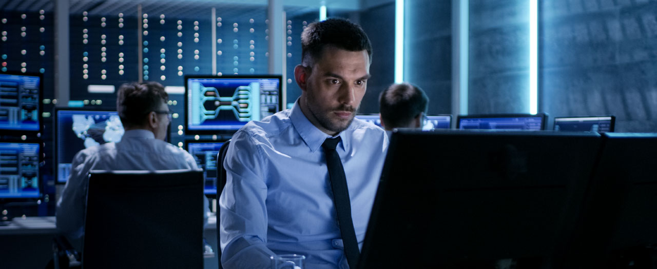 Cyber security professional working on computer