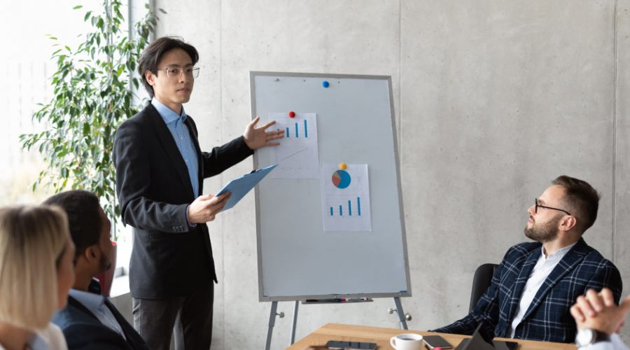 Young professional gives a presentation to employees