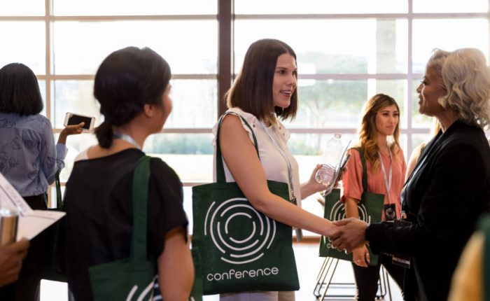 Instructional designers talk to one another at a conference