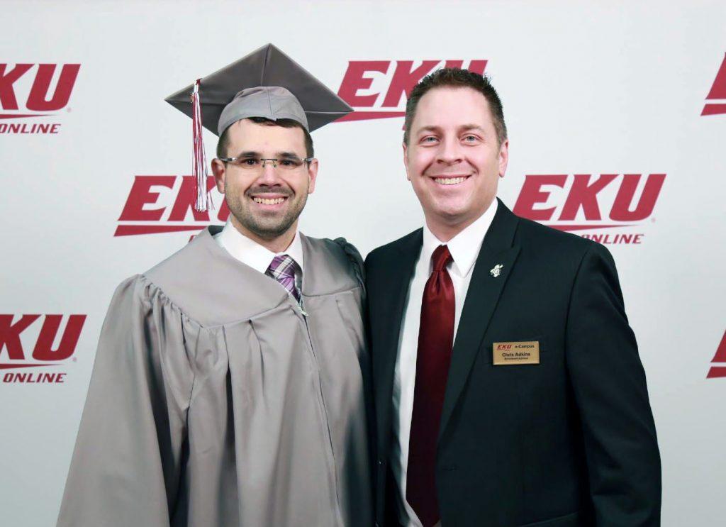 Michael Rega earns third degree and celebrates with EKU Online advisor Chris Adkins.